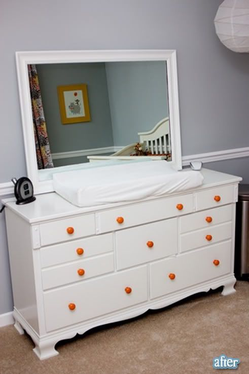 I've been thinking if painting Maya's furniture white...this may just make me go for it!  Love the pop of orange!