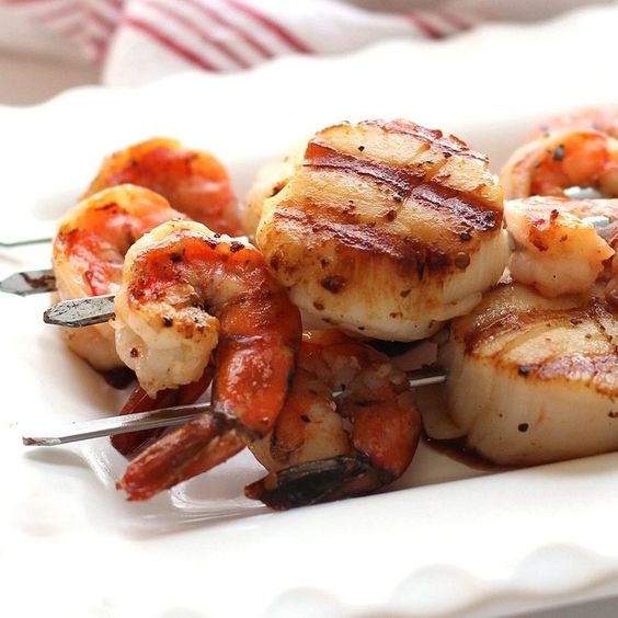 and scallops through skewers, brush with melted butter and seasoning ...