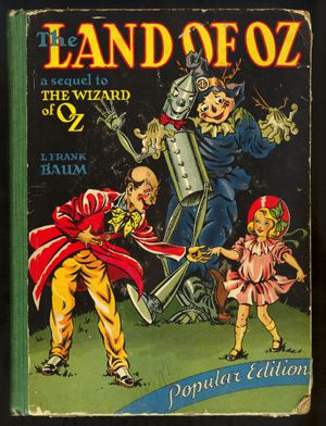 "*""THE LAND of OZ"" ~ a sequel to The Wizard of Oz.  Author: L. Frank Baum  Popular Edition.  Author of the Road to Oz, Dorothy and the Wizard of Oz, The Emerald City of Oz, Ozma of Oz, The Patchwork Girl of Oz, TIK-TOK of Oz, Etc. Etc.   Popular Edition  Ilustrated by John R. Neill  The Reilly & Lee Co.  Chicago  1939  (Copyright 1904 by L. Frank Baum, All rights reserved)  Published, July 1904.:"