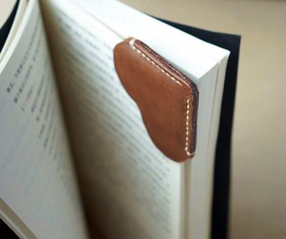 A leather bookmark corner with heart shape made of by for Leather shapes for crafts