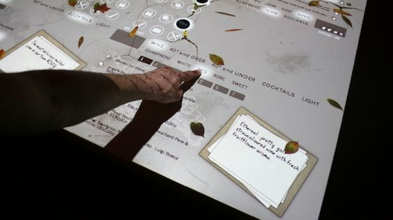 Touchscreen menus on the table: wouldnt call this good looking but a new idea anyhow!