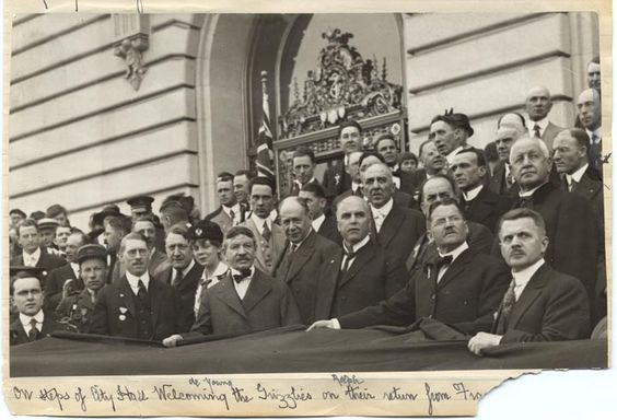 """Dignitaries, including Michael De Young and Mayor Rolph, on the steps of San Francisco City Hall welcoming """"Grizzlies"""" (soldiers) returning from World War I. From the Hamilton Henry Dobbin collection. 1919"""