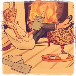 Woman reading in front of fire