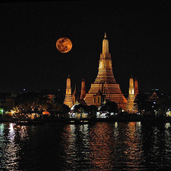 Wat Arun, the Temple of Dawn, is one of Bangkok's best know landmark. It stands on the west bank of the Chao Phraya River in Thon Buri. Wat Arun is best seen from the opposite bank of the river; it glistens in the sunlight during the day and stands dark and noble at dawn or dusk. -Pattpoom