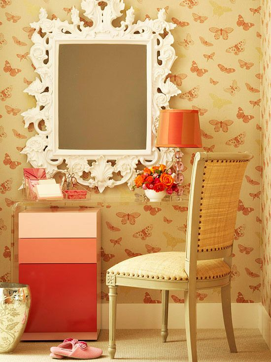 Tucking the pink drawer unit under the acrylic table provides space to store supplies.  Gorgeous mirror!: