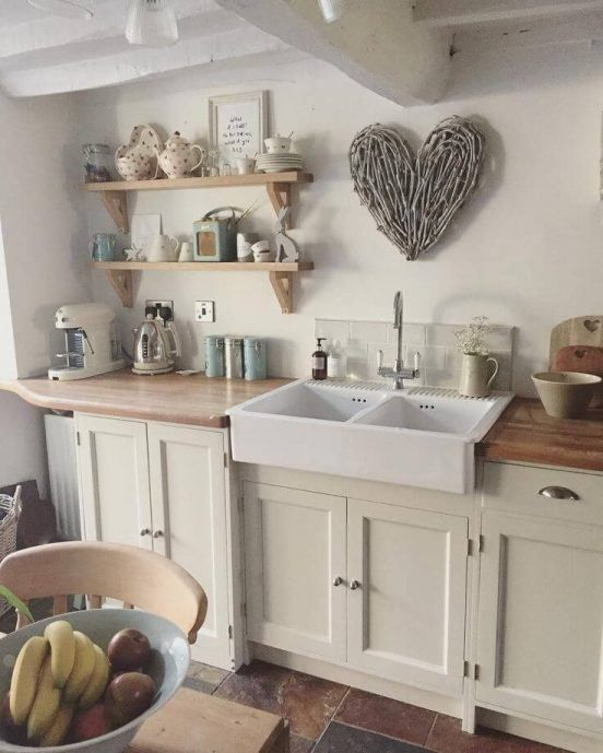 For An Elegant Take On The Cottage Kitchen Style Slather Your Walls In Warm Neutral Shades Cottage Kitchen Decor Small Cottage Kitchen Cottage Kitchen Design
