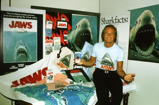 JAWS producer Richard Zanuck with a selection of JAWS lobby materials and merchandise.