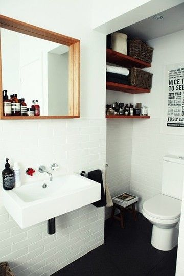 love black+white+wood bathrooms (from apt therapy)