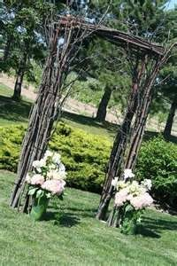 Rustic DIY wedding arch.  Dont know what to do with all those sticks and branches laying in your yard after the storm?  Transform them into a beautiful arch to showcase in your yard!