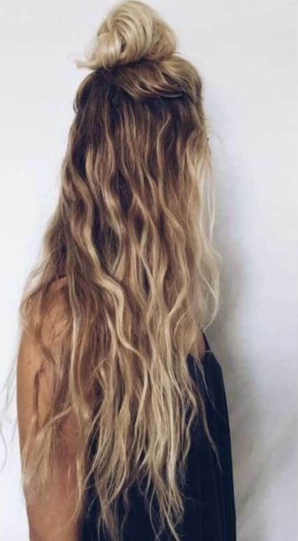When Waves Are Not Enough You Can Catch Some Attention By Putting A Half Bun On The Top Of Your Easy Hairstyles For Long Hair Long Wavy Hair Natural Wavy Hair