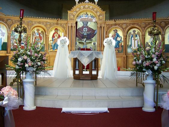 Church wedding flowers altar view at the assumption for Church wedding altar decoration ideas