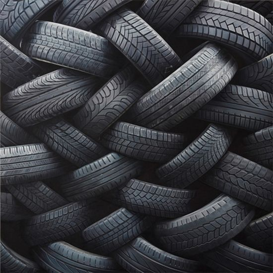 This is an example of texture. It is an example of texture because even though we cannot feel the tire we know from expirience what is feels like and we can picture it. We can also see also see the ridges and desgins.