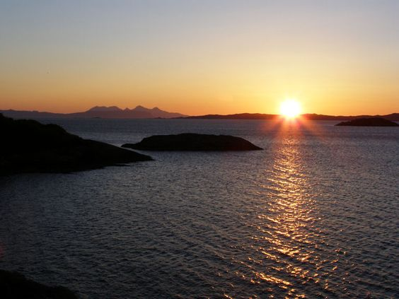 Mid summer sunset over Loch Ailort to Rum