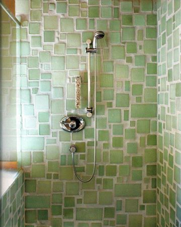 The article is about cleaning your grout, but all I am interested in is this sea glass looking tiled shower. The Hubs would loose his mind! He has enough glass to do it too!