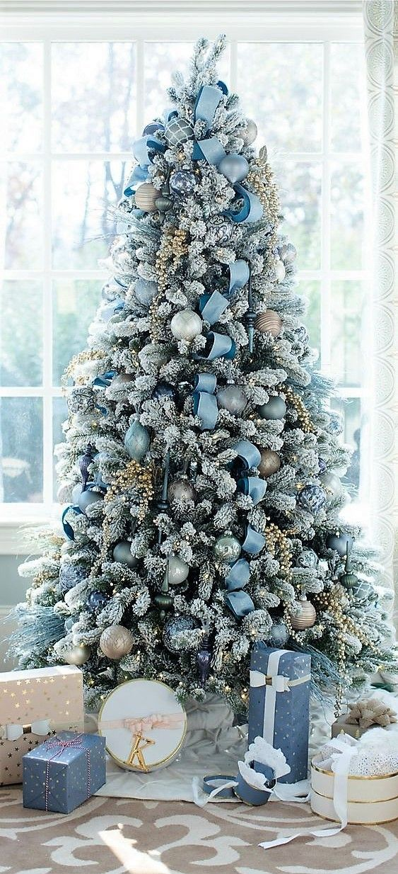 Flocked Christmas Tree With Icy Blue Color Palette Blue Christmas Decor Christmas Tree Themes Beautiful Christmas Trees