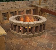 Enjoy your evenings outside by lounging around a Belgian Fire Ring. An ideal addition to your outdoor setting, this fire pit is easily constructed with Belgian Block and heavy-duty adhesive.: