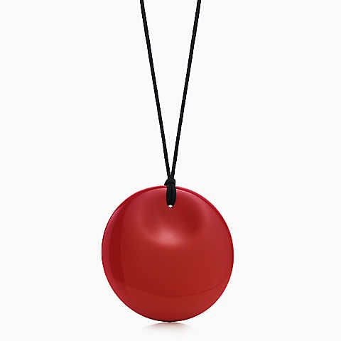 Elsa Peretti® Round pendant in red lacquer over Japanese hardwood.