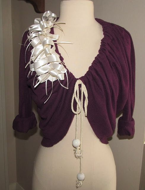 Minus the ribbon accents this is a super cute update to a cardigan... I might add some frilly flowers instead of the ribbon