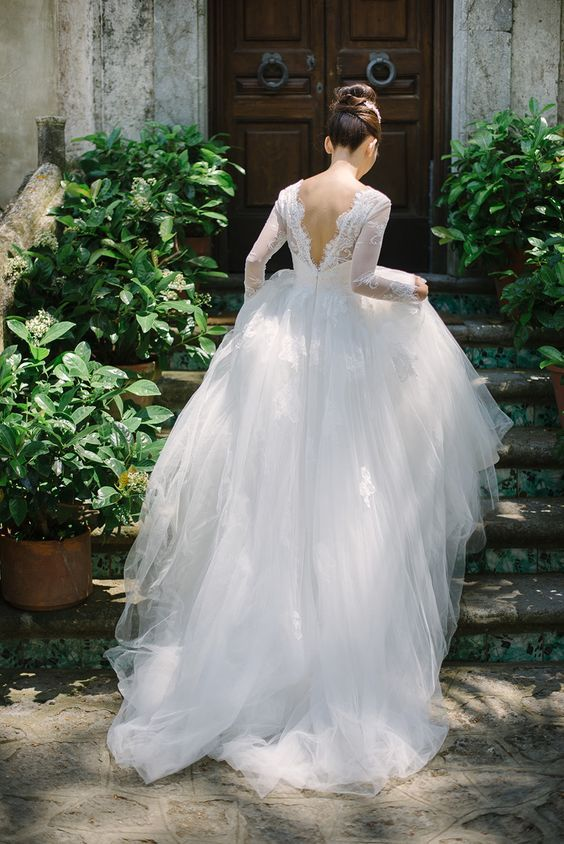 The details on this bride's lace embroidered tulle wedding gown {Facebook and Instagram: theweddingscoop}