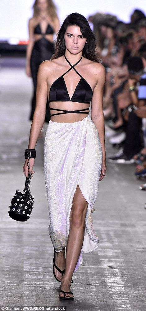 Bra-vo: Kendall strutted out in a lingerie meets bikini triangle top that featured straps which wrapped around the model's slender waist and neck