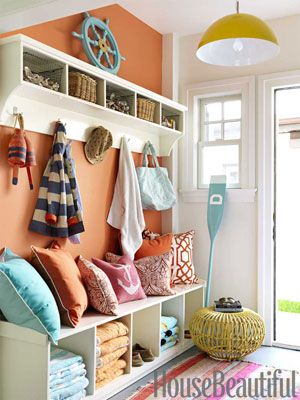Temper hot colors with cool ones. Designer: Mona Ross Berman. Photo: Jonny Valiant. housebeautiful.com #nautical #tangerine_tango #foyer #entry