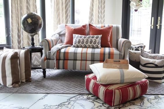 The sofa and pillows were chosen for their subtle color palette, consistent with an adult aesthetic while remaining playful.