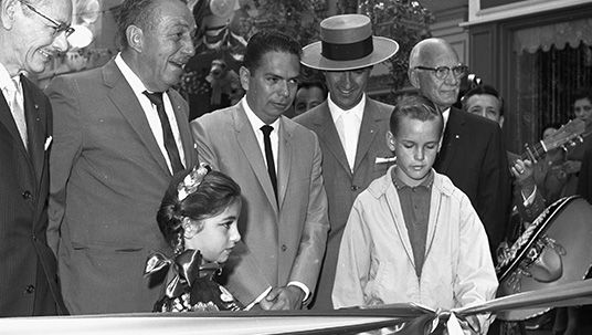 photo of Walt Disney dedicating the Salute to Mexico attraction at Disneyland, with a ribbon cutting ceremony by Teresa Lucero, 8, of Los Angeles and Patrick Wade, 12, of Anaheim; joined by Edmundo Gonzales, Mexico's Consul General in Los Angeles as well as Carlos Arruza, a famous bullfighter from Mexico City, and Joyce C. Hall, chairman of the People-to-People committee.