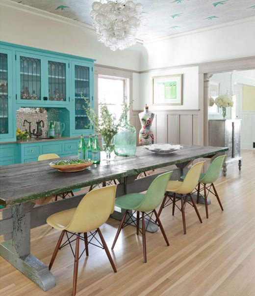 Turquoise china cabinet, molded plastic chairs, rustic paneling. Manhattan Beach bungalow photographed by Victoria Pearson featured in the new Country Living. The home was designed by architect Lewin Wertheimer and brought to life by the homeowners Chip and Bethany Herwegh. (He's a prop-maker, she's a costume designer–how cool is that?) You might know Bethany from her delightful blog The Glamorous Housewife.