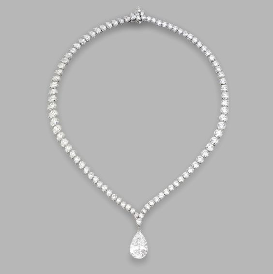 Platinum and diamond pendant necklace, Harry Winston. The pear-shaped diamond weighing 10.02 carats, completed by a necklace set with pear-shaped and round diamonds weighing a total of approximately 30.00 carats, length 16 inches, signed HW for Harry Winston, numbered 65522 and 64108.