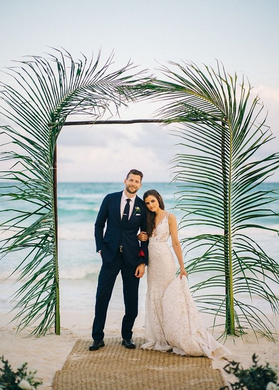 Simple modern palm leaves for beach wedding ceremony arch.  | Wedding | Beach Wedding | Beach Wedding Ideas | Bride | Groom | Wedding Photography | #weddings #beach #beachwedding #weddinginspiration #weddingphotography | www.laurenlashdesigns.com