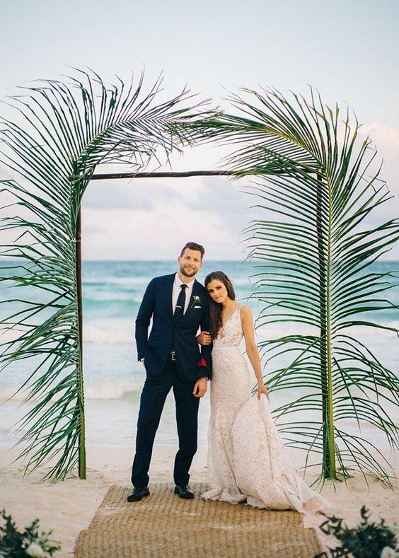 Simple modern palm leaves for beach wedding ceremony arch.  | Wedding | Beach Wedding | Beach Wedding Ideas | Bride | Groom | Wedding Photography | #weddings #beach #beachwedding #weddinginspiration #weddingphotography | www.laurenlashdesigns.com