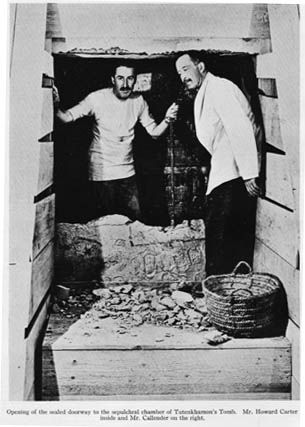 Howard Carter at the entrance to the tomb of  Egyptian King Tutankhamen....Pyramids.