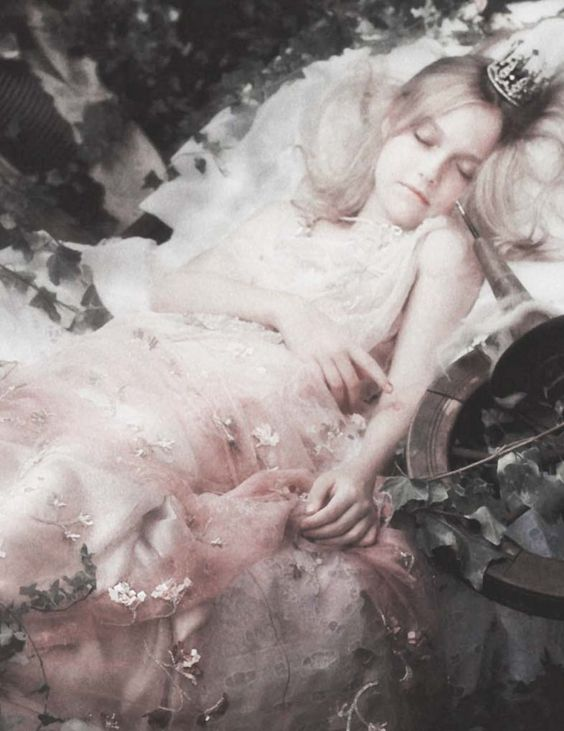 Dakota Fanning plays sleeping beauty in 'Cinderella In Sneakers' by Karl Lagerfeld for Vanity Fair January 2007