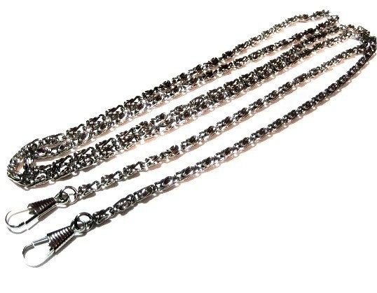 A vintage 46 silver tone chain with 1 watch clips on both ends. Im not sure if it was a necklace or possibly a purse strap.It chain measures 4mm