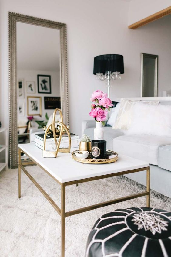 white and gold coffee table || black pouf || floor mirror: