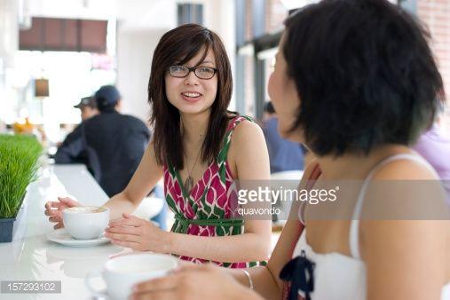 Stock Photo : Asian Teenage Friends Talking at Urban Coffee Shop