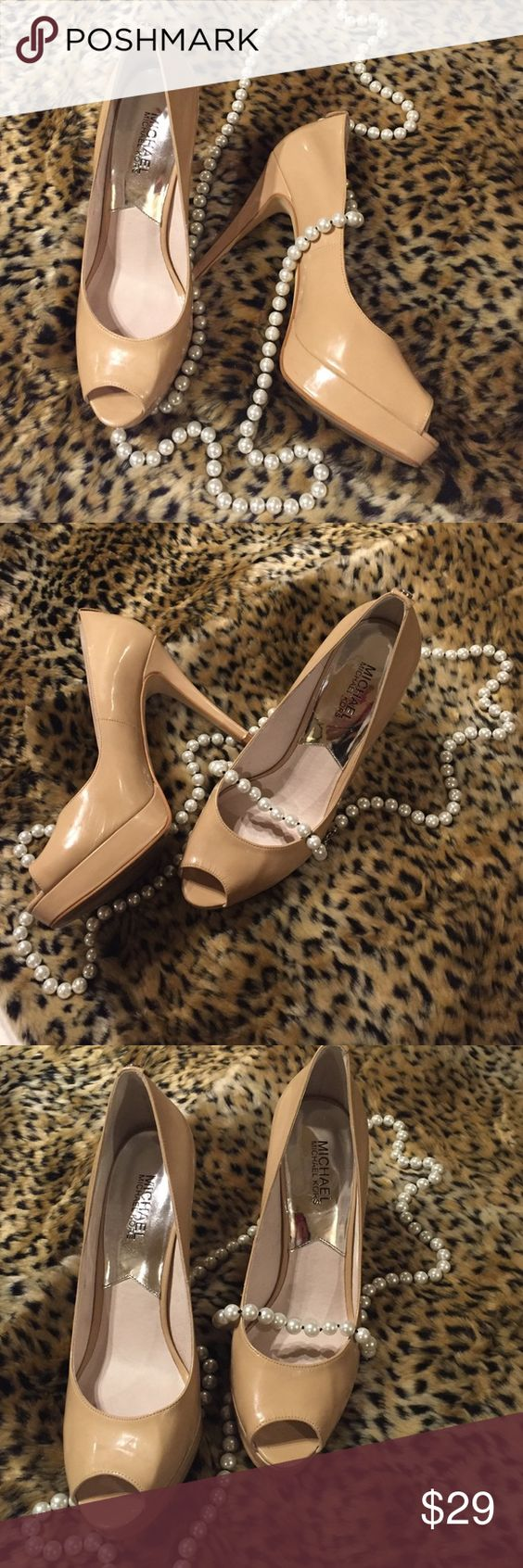 Michael Kors nude peep toe pumps Gorgeous nude pumps worn once and like new. Not shiny but not totally matte extremely classic. 4 inch heel with 1 inch platform on front. A great deal! Michael Kors Shoes Heels