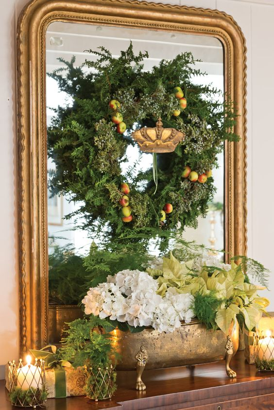 Gold gilded mirror with wreath and greens
