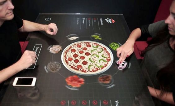 #PizzaHut revealed their touch-screen table concept that allows customers to design their pizza in every little detail, from the size of the pie to how the toppings are distributed. Find more: http://impressivemagazine.com/2014/03/04/pizza-huts-interactive-table-makes-ordering-pizza-fun/