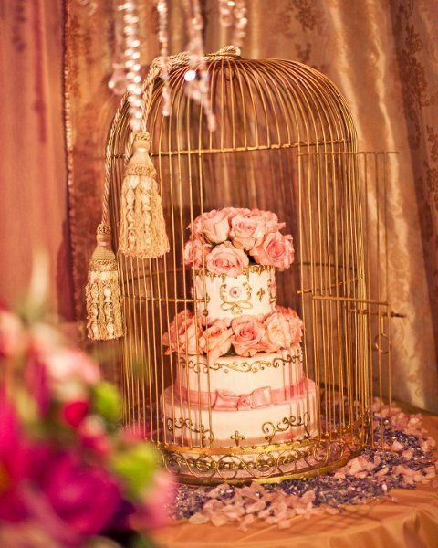 I like the 'inside the birdcage' cake!!!  Hollywood Glam Romantic Vintage Gold Multicolor Pink Décor Dessert Flowers Indoor Reception Rose Round Topper Wedding Cake Wedding Cakes Photos & Pictures - WeddingWire.com