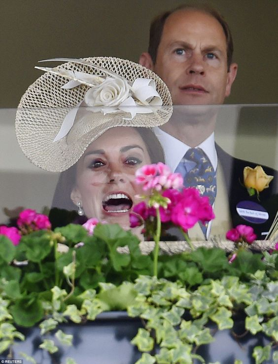 The Duchess of Cambridge reacts during the races while Prince Edward looks on: