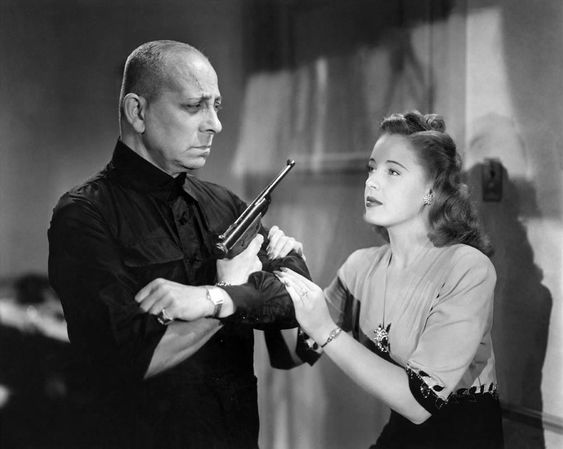 Erich von Stroheim and Mary Beth Hughes in The Great Flamarion (1945) Directed by Anthony Mann)