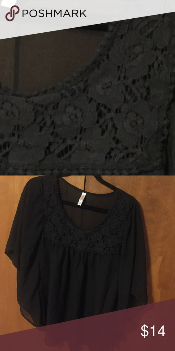 Black shirt Slightly warn black shirt with flower embellishment. Perfect for work or fun. Xhilaration Tops Blouses