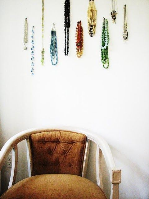 My daughter thought I was crazy  when I hung a lot of my jewelry up on the wall in my bedroom - finding this photo on an interior designer's blog (she did this in her own room) helped me feel validated in my decision!