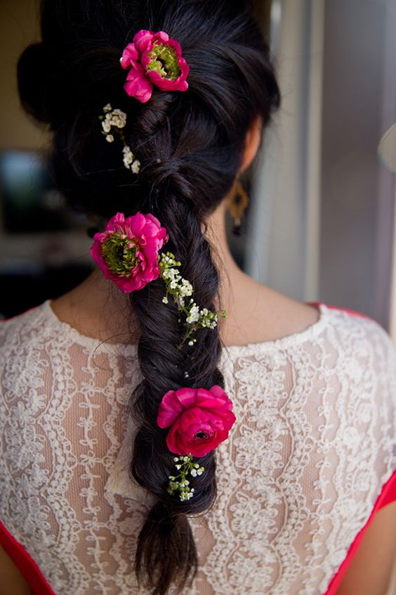 This fish tail braid with pink flowers and baby's breath is so beautiful | Hairstyle inspiration for Indian brides | Mehendi hairstyle inspiration | Flower in hair | Fish tail braid | Fishtail Braids with Pink Flowers | hairstyles for Bridesmaids Indian | Function Mania | 7 Easy Hairstyles for Bridesmaids Trending this Season!