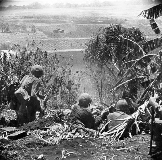"<b>Caption from LIFE.</b> ""Marines follow tanks against last Jap defenders as machine gunners keep Japs down. Three men alongside photographer were hit just before he took picture."""