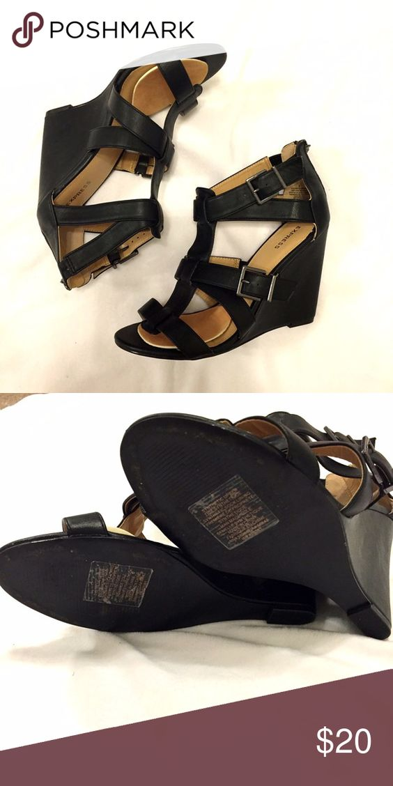 Express Black Sandal Wedges Size 8 Express Black Size 8 wedges. Worn once. These wedges do have shoe pedals inside on ball of foot for comfort. Excellent condition. Please ask any questions before purchase.          ✔️Offers Welcome, 📦Bundle for combined shipping and discount. Express Shoes Wedges
