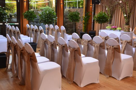 Gorgeous hessian chair covers from http://www.venueperfection.com
