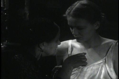 """(feels the fabric of a guest's low-cut gown) """"That's fine stuff, but it'll rot."""" (touches her skin above the neckline) """"That's finer stuff still, but it'll rot too... in time!""""  (and)  (recurring line) """"No beds!""""  Eva Moore as Rebecca Femm (pictured on left with Gloria Stuart as Margaret Waverton) in 'The Old Dark House'"""