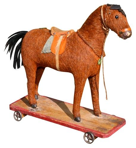 Antique German Horse pull toy on a wooden platform with metal wheels. These were popular c. 1900.  She is not in perfect condition-one hoof is missing and the tack is not complete, thus the low price. Selling as-is.     But, what a pretty face!  VandM (Vintage and Modern),